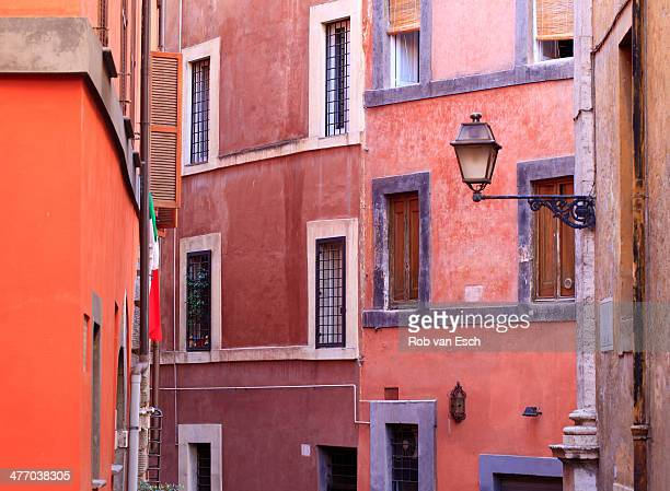 Colorful architecture in Rome, capital of Italy, Europe, with the typical warm, red and orange, colors that are used throughout the city. The image...