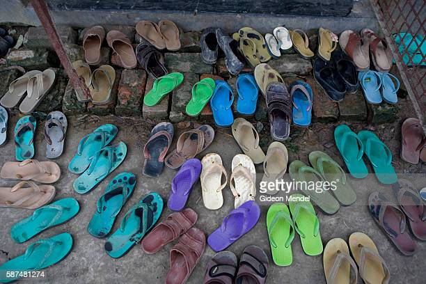 Colorful array of flip flops and sandals outside the mosque during Friday prayers on the island of Aralia, a shrinking island of silt which is one...