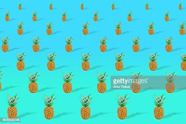 Colorful art composition with pineapple repetition in a space with perspective and colorful background.