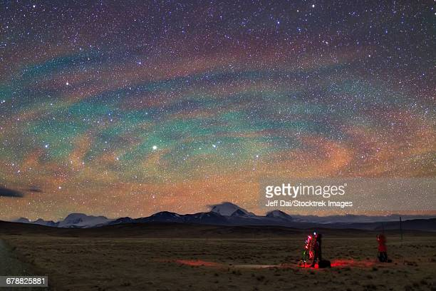 Colorful atmospheric gravity waves called airglow over Tibet.