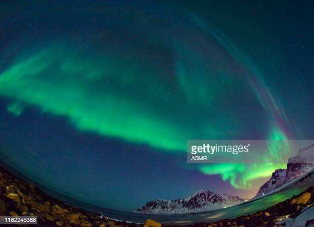 colorful aurora borealis dancing in the sky - marginata stock pictures, royalty-free photos & images