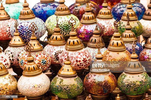 Colorful authentic and traditionally handmade lanterns, chandeliers or mosaic lamps selling on the Turkish Grand Bazaar in Istanbul, Turkey. Turkish or moroccan culture. Handmade lighting.
