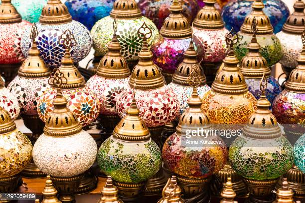 colorful authentic and traditionally handmade lanterns, chandeliers or mosaic lamps selling on the turkish grand bazaar in istanbul, turkey. turkish or moroccan culture. handmade lighting. - istanbul stock pictures, royalty-free photos & images