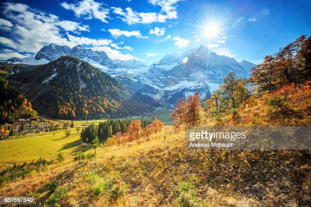 Colorful autumn mood with snow covered mountains, Großer Arhornboden, Karwendelgebirge.