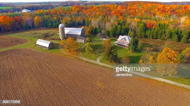 colorful autumn rural forest and farm landscape. - wisconsin stock pictures, royalty-free photos & images