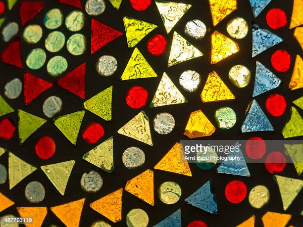 Colorful backlit glass triangles and circles