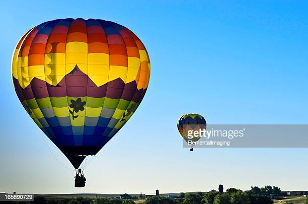 Colorful Backlit Hot Air Balloons Launcing at Sunrise