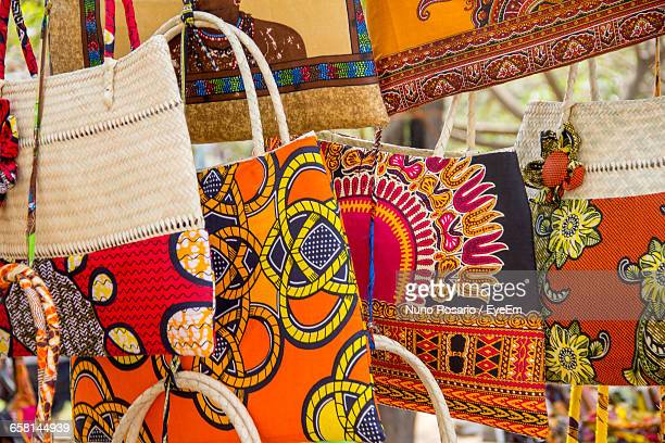 colorful bags hanging at market for sale - mozambique stock pictures, royalty-free photos & images