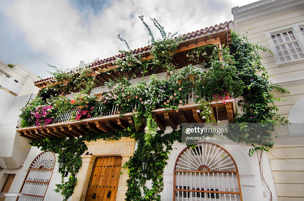 Colorful balcony with flowers in Cartagena : Stock Photo