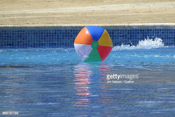 Colorful Ball Floating On Swimming Pool