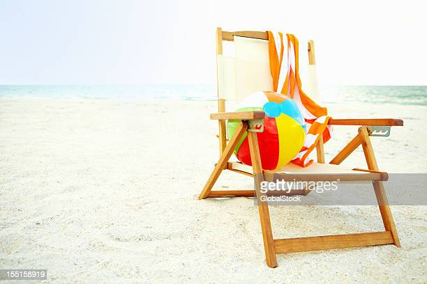 Colorful ball lying on a chair at the beach