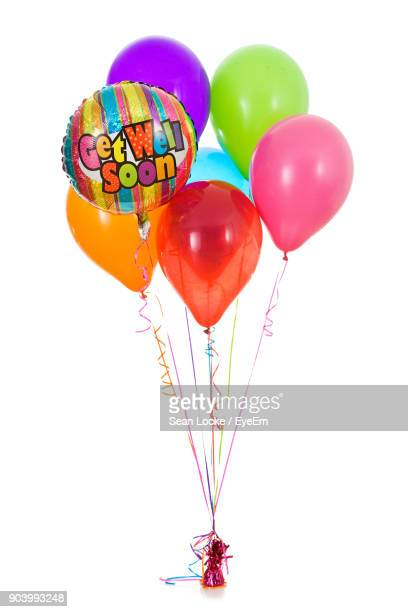Colorful Balloons Against White Background