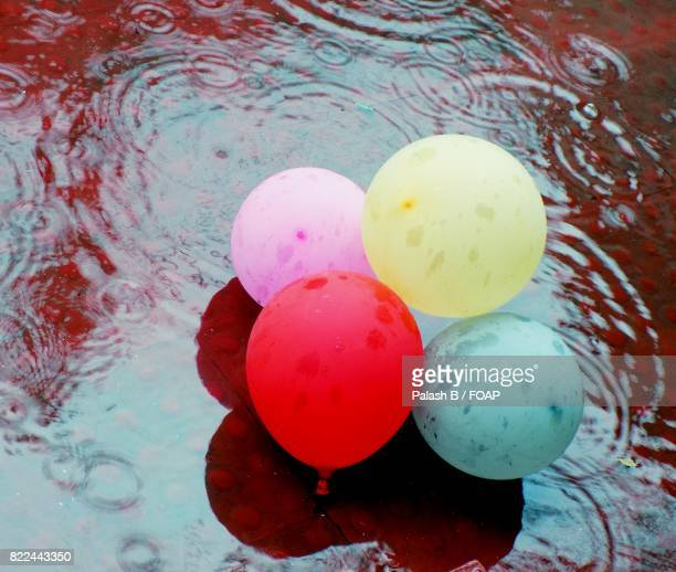 Colorful balloons in rain