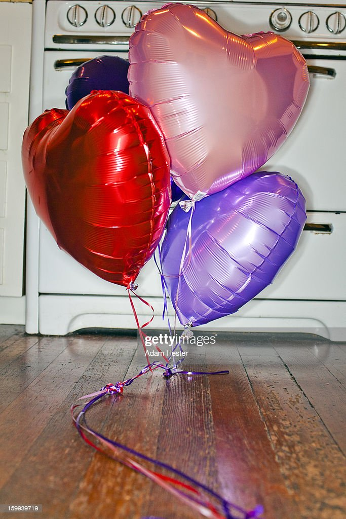 Colorful balloons inside the kitchen of a home. : Stock Photo