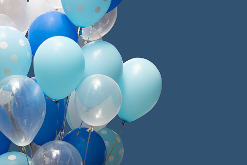 colorful balloons on blue background. happy new year and happy birthday concept 1131774738