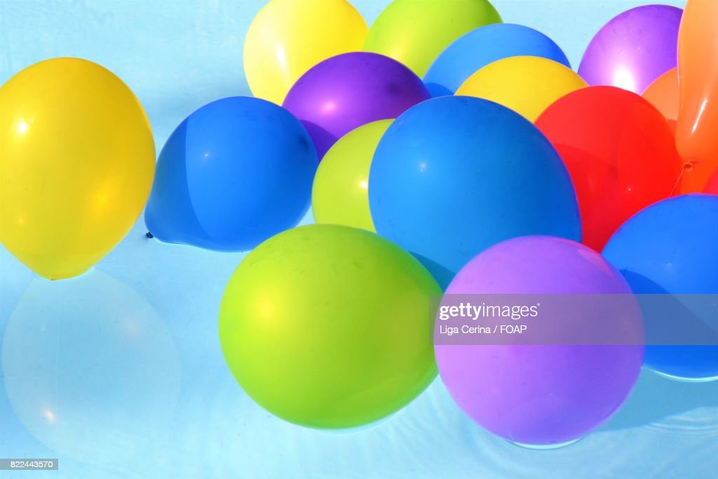 Colorful balloons on water : Stock Photo