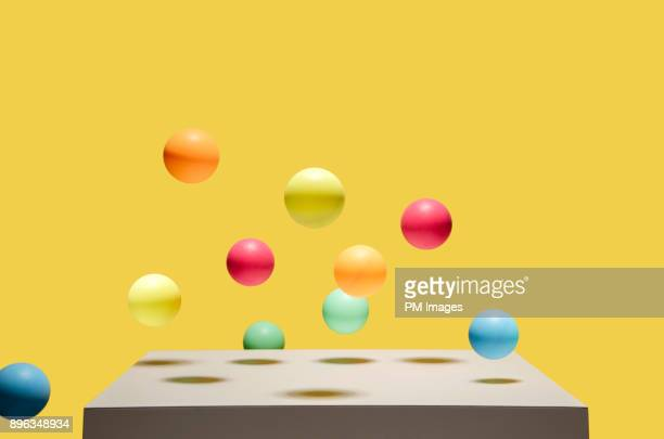 colorful balls bouncing - bontgekleurd stockfoto's en -beelden
