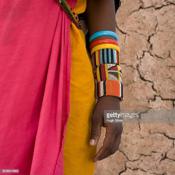 colorful bangles on maasai woman's arm - hugh sitton stock pictures, royalty-free photos & images