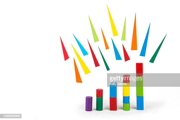 colorful bar graph with toy blocks - triangle percussion instrument stock photos and pictures