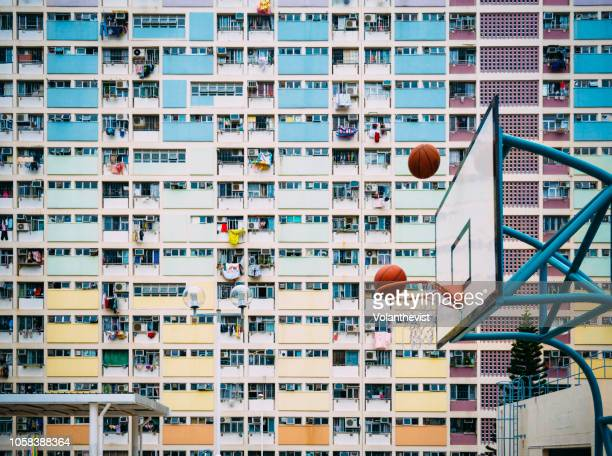 colorful basketball court in kowloon, hong kong, china - local landmark stock pictures, royalty-free photos & images