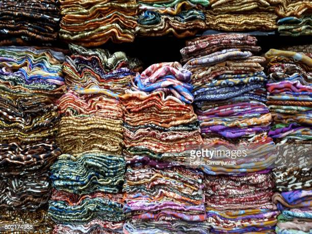 colorful batik clothes piled up at market for sale in yogyakarta indonesia - indonesian cloth 個照片及圖片檔