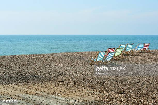 colorful beach chairs on brighton beach - brighton beach england stock pictures, royalty-free photos & images