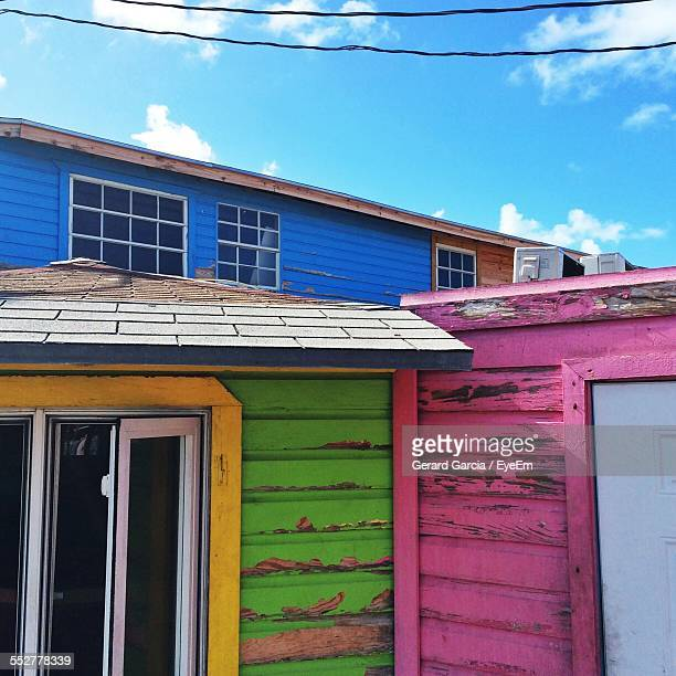 colorful beach hut against blue sky - nassau stock photos and pictures