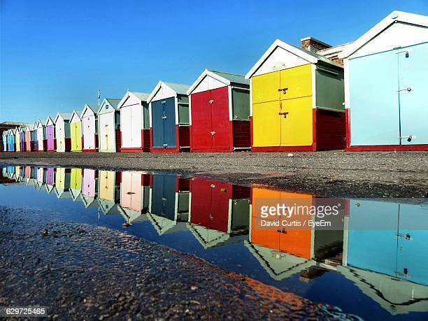 colorful beach huts against sky - hove stock pictures, royalty-free photos & images