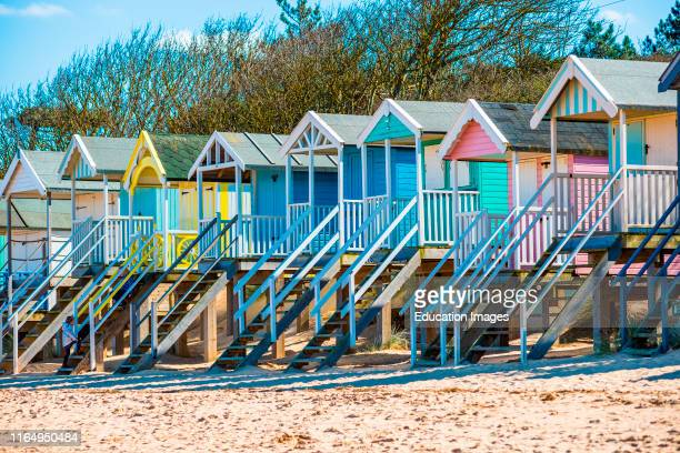 Colorful beach huts on Wells beach at Wells next the Sea on North Norfolk coast East Anglia England UK