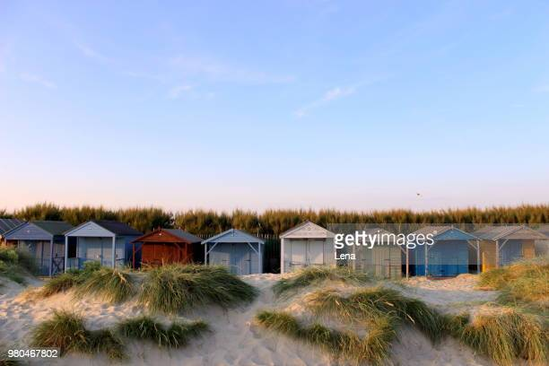 colorful beach huts, west wittering, chichester, west sussex, england, uk - chichester stock pictures, royalty-free photos & images