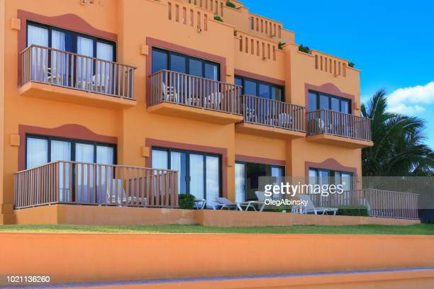 colorful beach resorts at caribbean sea with blue sky, cancun, mexico. - quintana roo stock pictures, royalty-free photos & images