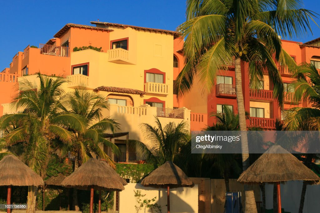 Colorful Beach Resorts Lit By The Sunset Sun At Caribbean