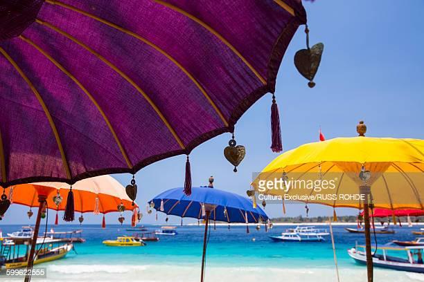 Colorful beach umbrellas on beach, Gili Trawangan, Lombok, Indonesia