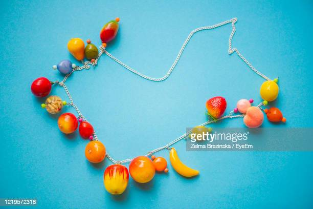 colorful beads for young lady - necklace stock pictures, royalty-free photos & images