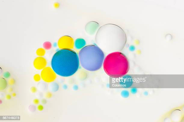 Colorful beads in white liquid