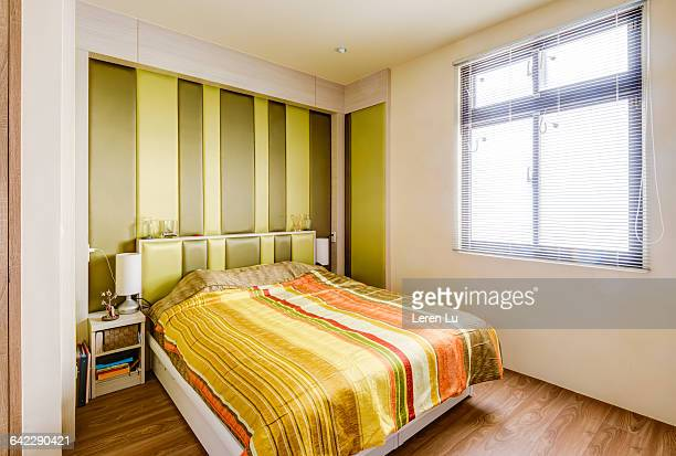 Colorful bed in comfortable bedroom