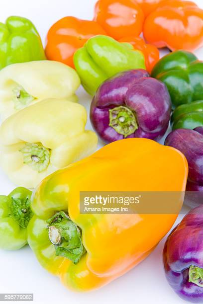 colorful bell peppers, close up, white background - pimiento naranja fotografías e imágenes de stock
