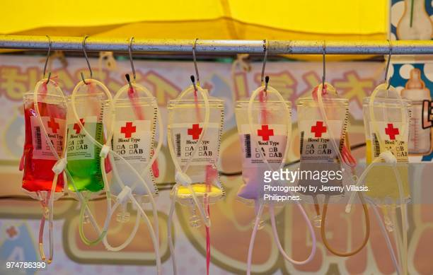 colorful beverages on iv bags - blood group stock pictures, royalty-free photos & images