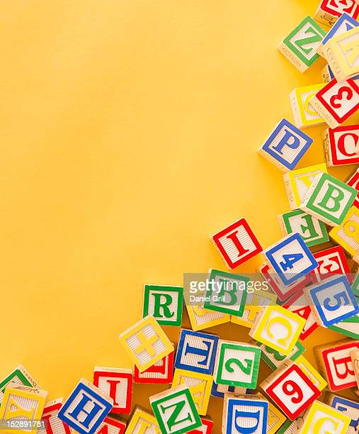 colorful blocks with alphabet letters - capital letter stock pictures, royalty-free photos & images