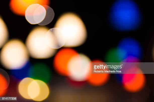 Colorful blurry traffic lights in downtown city Vision of drunk man