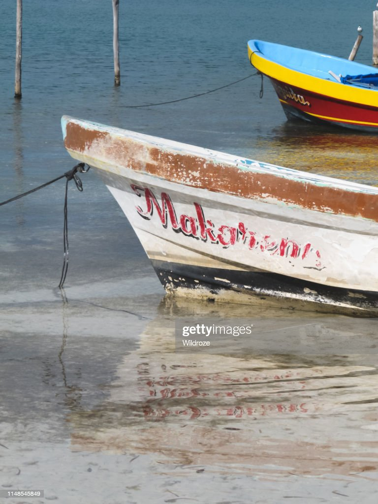 Colorful boat floating in the sea, Caribbean island of Isla Mujeres, Mexico : Stock Photo