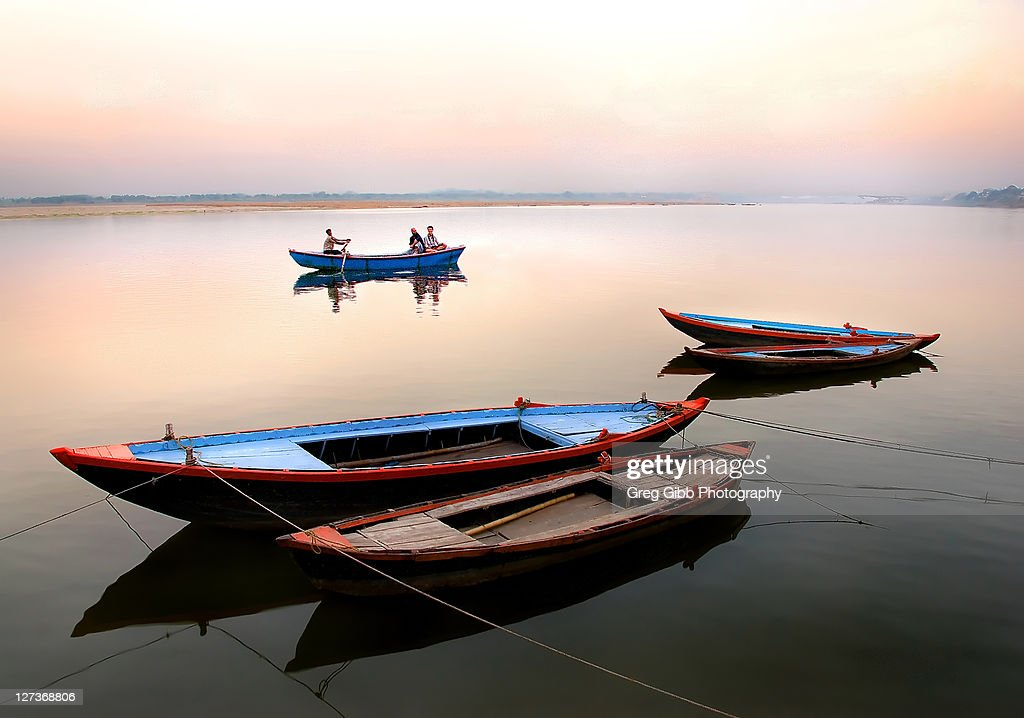 Colorful boats moored on Ganges river : Stock Photo