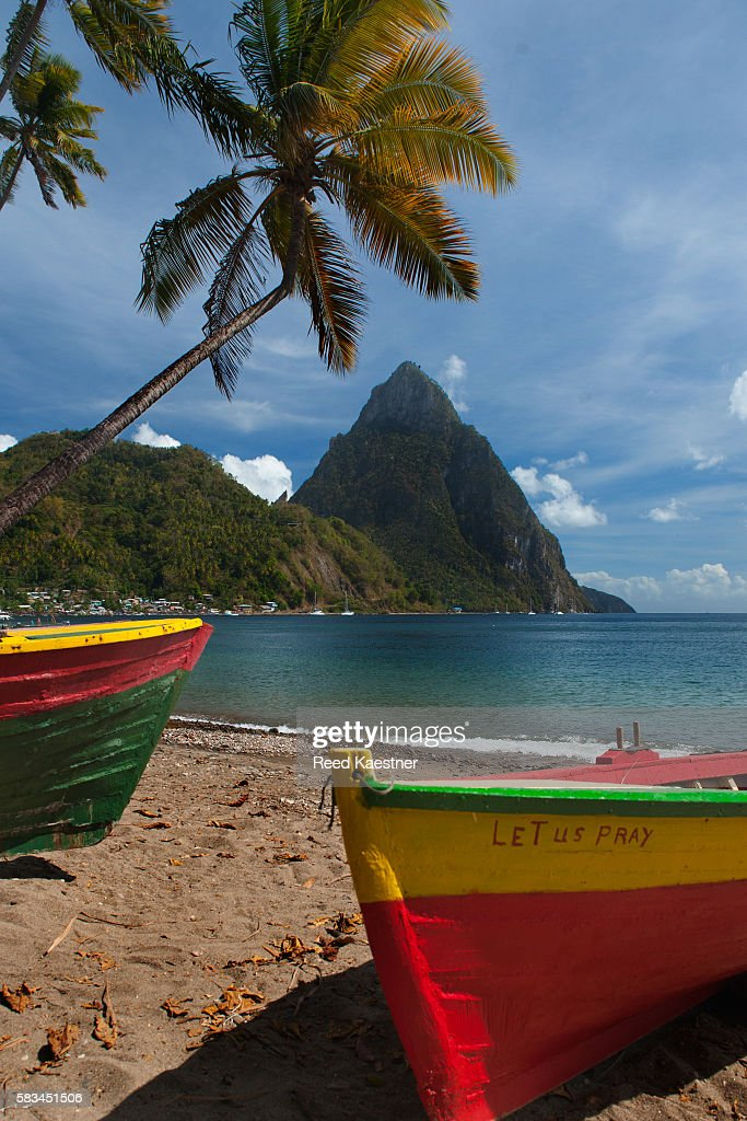 Colorful boats on the beach in  Soufrieire, St Lucia with the Pitons in the background.The famous Pitons of St Lucia are volcanic plugs rising out of the sea at the south end of the island. : Stock Photo