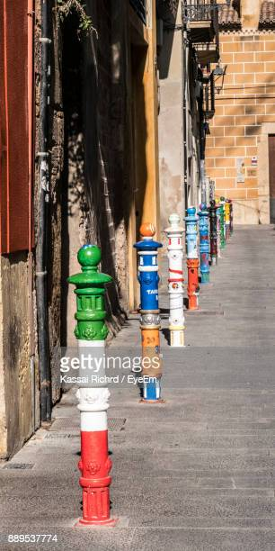 Colorful Bollards On Street By Building