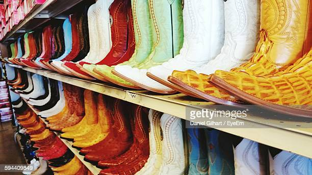 Colorful Boots On Rack At Shop