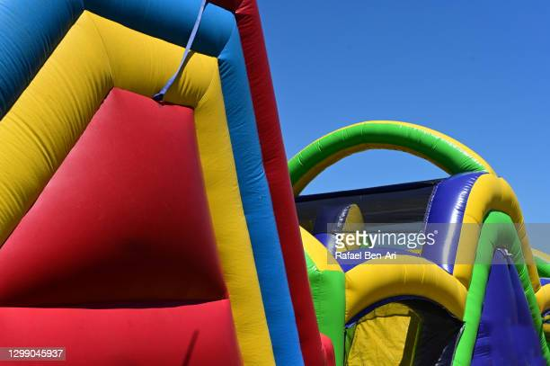 colorful bouncing castles - rafael ben ari stock pictures, royalty-free photos & images
