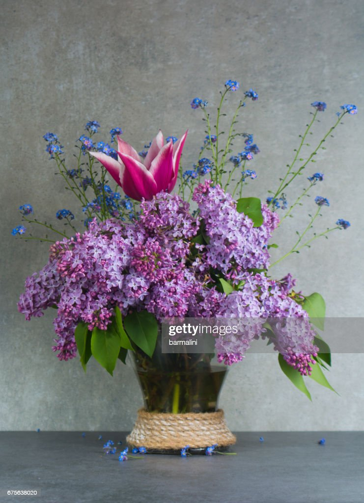 Colorful Bouquet In Glass Vase With Purple Lilac Pink Tulip And Blue