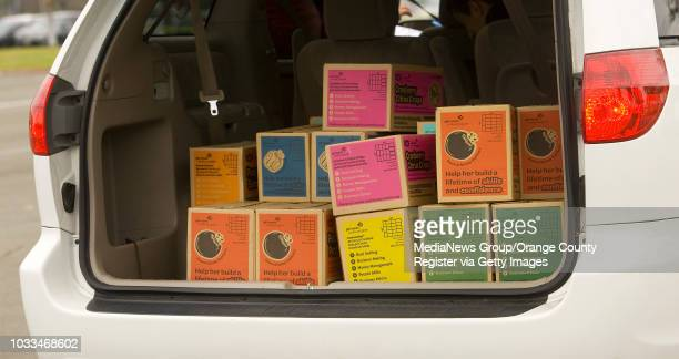 Colorful boxes of Gril Scout cookies fill the back of a minivan at the Costa Mesa distribution center ///ADDITIONAL INFO Photo by MINDY The Orange...