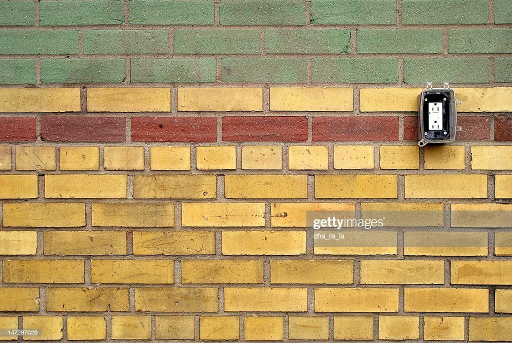 Colorful Brick Wall With Electrical Outlet Stock Photo | Getty Images