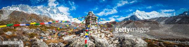colorful buddhist prayer flags flying high in himalaya mountains nepal - nepal stock pictures, royalty-free photos & images